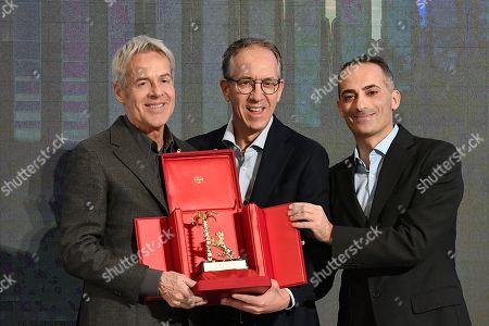 Claudio Baglioni receives the 'Amico di Sanremo ' Award (Friends of Sanremo) from the Mayor of Sanremo Alberto Biancheri (center)