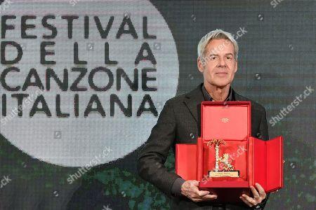 Stock Photo of Claudio Baglioni receives the 'Amico di Sanremo ' Award (Friend of Sanremo) during the final press conference