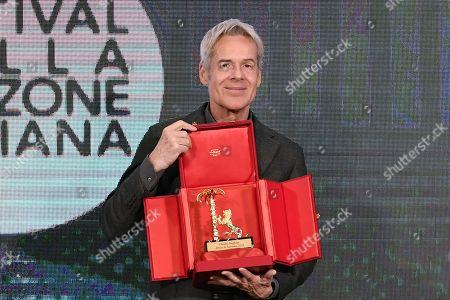 Claudio Baglioni receives the 'Amico di Sanremo ' Award (Friend of Sanremo) during the final press conference
