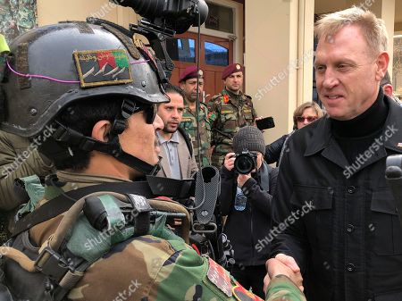 Acting Secretary of Defense Pat Shanahan greets an Afghan commando at Camp Commando, Afghanistan on . The unannounced visit is the first for the acting secretary of defense, Pat Shanahan. He previously was the No. 2 official under Jim Mattis, who resigned as defense chief in December