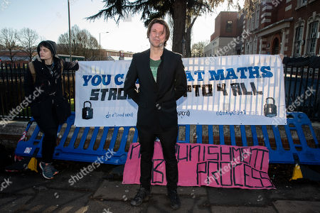 Lauri Love poses for photos before arriving at Hendon Magistrates' Court. Love, an alleged hacker, is using the 'Police (Property) Act of 1897' to seek the return of his computers which were seized by police over five years ago. Last year, The High Court blocked Love's extradition to the United States.