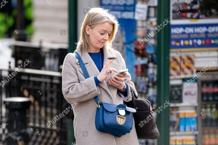 Chief Secretary to the Treasury Liz Truss walking through Piccadilly Circus in central London this afternoon.