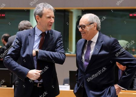 Austrian Finance Minister Hartwig Loeger and Malta's Finance Minister Edward Scicluna (R) talk during the Eurogroup Finance Ministers' meeting in Brussels, Belgium, 11 February 2018. The Europgroup will discuss the nomination for the upcoming European Central Bank ECB vacancy.