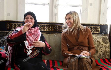 Queen Máxima of the Netherlands, the UN Secretary-General's Special Advocate for Inclusive Finance for Development, visit the house of visits the house of Fatima Al Zobi, left, in Salt, about 18 miles (30 km) north of Amman, Jordan, . Queen Máxima is scheduled to meet with King Abdullah II and Queen Rania during her two-day visit to Jordan
