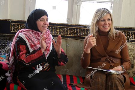 Queen Máxima of the Netherlands, the UN Secretary-General's Special Advocate for Inclusive Finance for Development, visits the house of Fatima Al Zobi, left, in Salt, about 18 miles (30 km) north of Amman, Jordan, . Queen Máxima is scheduled to meet with King Abdullah II and Queen Rania during her two-day visit to Jordan