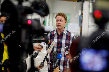 Stock Picture of Evan Jones (C), coordinator of ASIA Pacific Refugee Rights Network talks to journalists at the airport regarding the status of Bahraini soccer player with Australian refugee status Hakeem Al-Araibi (not pictured), following his release in Bangkok, Thailand, 11 February 2019. Hakeem Al-Araibi was released on 11 February after after Bahrain withdrew its request to have him extradited and is expected to fly back to Australia after midnight. Al-Araibi, a former Bahrain's national soccer player, was detained by Thai authorities in late November 2018. Hakeem Al-Araibi fled to Australia from Bahrain in 2014, claiming that he was tortured after he was arrested an alleged vandalism act.