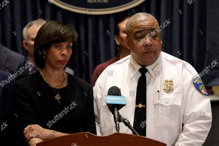 Baltimore Mayor Catherine Pugh, left, and Michael Harrison, center, acting commissioner of the Baltimore Police Department, listen to a reporter's question at an introductory news conference for Harrison, in Baltimore. Harrison, the former Superintendent of the New Orleans Police Department, started Monday as acting leader weeks before the city council is expected to vote on his nomination as permanent police commissioner