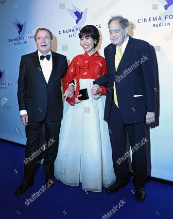 Former German Chancellor Gerhard Schroeder (SPD) and his South Korean wife Soyeon Kim with Swiss producer Arthur Cohn attend the Cinema For Peace Gala during the 69th annual Berlin Film Festival, in Berlin, Germany, 11 February 2019. Berlinale runs from 07 to 17 February.