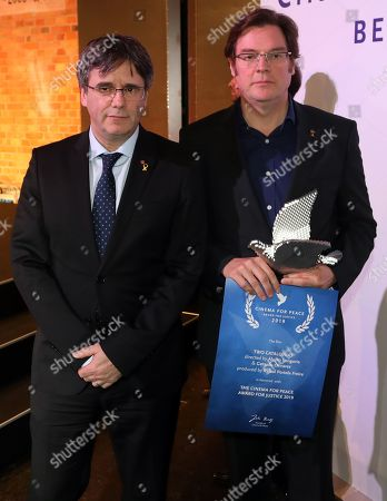 Former Catalan President Carles Puigdemont (L) with director Alvaro Longoria (R) pose with Award for Justice by Cinema for Peace for Netflix documentary film 'Two Catalonias' during the Cinema For Peace Gala during the 69th annual Berlin Film Festival, in Berlin, Germany, 11 February 2019. Berlinale runs from 07 to 17 February.