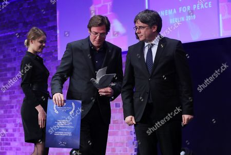 Former Catalan President Carles Puigdemont (R) with director Alvaro Longoria (C) pose with Award for Justice by Cinema for Peace for Netflix documentary film 'Two Catalonias' during the Cinema For Peace Gala during the 69th annual Berlin Film Festival, in Berlin, Germany, 11 February 2019. Berlinale runs from 07 to 17 February.