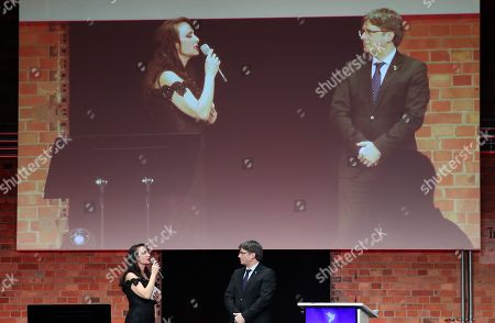 Former Catalan President Carles Puigdemont (R) listens Anna Maria Kaufmann (L) singing 'Don't cry for me Catalonia' during the Cinema For Peace Gala during the 69th annual Berlin Film Festival, in Berlin, Germany, 11 February 2019. Berlinale runs from 07 to 17 February.