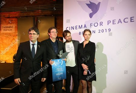 Stock Picture of Former Catalan President Carles Puigdemont (L) with members of Pussy Riot, Pyotr Verzilov (2-R) and Veronika Nikulshina (R) and director Alvaro Longoria (2L) pose with Award for Justice by Cinema for Peace for Netflix documentary film 'Two Catalonias' during the Cinema For Peace Gala during the 69th annual Berlin Film Festival, in Berlin, Germany, 11 February 2019. Berlinale runs from 07 to 17 February.