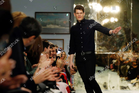Creative Director Wes Gordon acknowledges audience applause after the Carolina Herrera collection is modeled during Fashion Week in New York