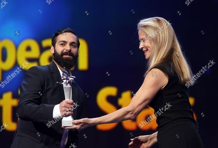 Stock Photo of 'Shooting Star' Ardalan Esmail (L) from Sweden is seen on stage next to US producer Martha De Laurentiis (R) ahead of the of 'Vice' during the 69th annual Berlin Film Festival, in Berlin, Germany, 11 February 2019. The movie is presented in the Official Competition at the Berlinale that runs from 07 to 17 February.