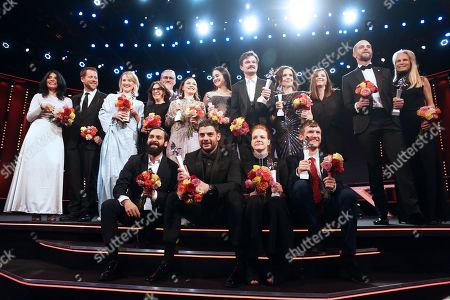 Stock Picture of Teona Strugar Mitevska, Macdara Kelleher, Ine Marie Wilmann from Norway, Ardalan Esmail from Sweden, Avy Kaufman, Ingvar Sigurdsson, Emma Drogunova from Germany, Milan Maric from Serbia, Aisling Franciosi from Ireland, Dawid Ogrodnik from Poland, Rea Lest from Estonia, Kristin Thora Haraldsdottir from Iceland, Elliott Crosset Hove from Denmark, Tara Karajica, Blagoj Veselinov from Macedonia and Martha De Laurentiis are seen on stage at the European Shooting Stars 2019 ceremony ahead of the 'Vice' premiere during the 69th annual Berlin Film Festival, in Berlin, Germany, 11 February 2019. The movie is presented in the Official Competition at the Berlinale that runs from 07 to 17 February.