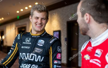 IndyCar driver Marcus Ericsson, of Sweden, speaks with fellow driver Ed Jones during IndyCar auto racing media day, in Austin, Texas