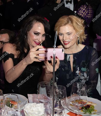 Anna Maria Kaufmann (L) and Minister of Food and Agriculture Julia Kloeckner take selfies at the Cinema For Peace Gala during the 69th annual Berlin Film Festival, in Berlin, Germany, 11 February 2019. Berlinale runs from 07 to 17 February.
