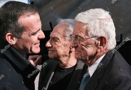 Billionaire philanthropist Eli Broad, right, is greeted by Los Angeles Mayor Eric Garcetti, left as architect Frank Gehry, center, looks on prior to a groundbreaking ceremony for The Grand, a long-delayed massive development in downtown Los Angeles on . Broad told attendees Monday that the project stems from a vision of Grand Avenue becoming the arts, cultural and civic district for the region