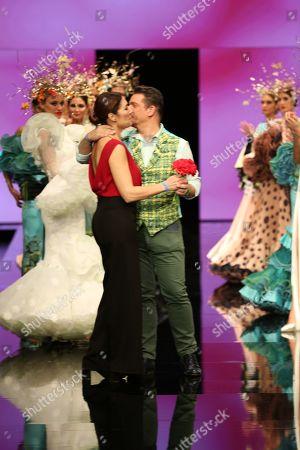 Designer Francisco Tamaral and Raquel Revuelta on the catwalk