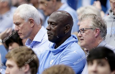 Michael Jordan, Buzz Peterson, Mitch Kupchak. Charlotte Hornets owner and former North Carolina great Michael Jordan, center, watches North Carolina play Virginia during an NCAA college basketball game in Chapel Hill, N.C., . At right is former North Carolina player Buzz Peterson, assistant general manager of the Hornets, and at left is former North Carolina player Mitch Kupchak, general manager of the Hornets. Peterson knew Jordan as well as anyone when they were in college. Roommates and teammates at North Carolina, they spent countless days competing on the basketball court in practice and endless hours talking hoops. But Peterson never saw this coming: His roommate becoming an NBA owner and hosting the league's All-Star game in his home state of North Carolina