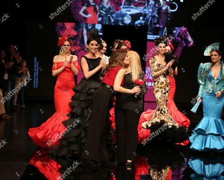Designer Gloria Patricia Sanchez and Raquel Revuelta on the catwalk