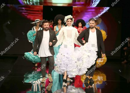 Designers Sergy Garrido and Tapiju with model Noelia Lopez on the catwalk