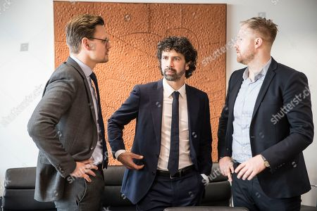 Stock Photo of Secretary General of footballers' federation FIFPro Europe Jonas Baer-Hoffmann, left, talks with Alexander Bielfed, Senior Manager Policy & Strategic Relation atv FIFpro, right, and Damiano Tommasi, former player and President of the italian Footballer's association (AIC) at the European Parliament in Strasbourg, eastern France, Tuesday, Feb.12, 2019