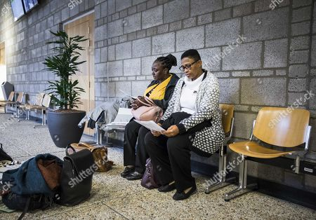 Victoria Bera (L) and Esther Kiobel, two of the widows who lost husbands by execution in 1995, are seen at court to file a civil court case against Dutch-British multinational oil company, The Hague, The Netherlands, 12 February 2019. According to media reports, four Nigerian widows filed a court case allegedly accusing Shell of having instigated the executions of their late husbands claiming they were activists targeted as they were opposing environment damage caused by the Nigerian subsidiary of Shell.