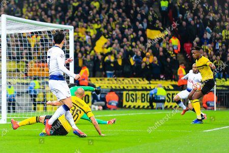 Son Heung-min (07) of Tottenham watches his shot saved by Roman Burki (01) of Borussia Dortmund