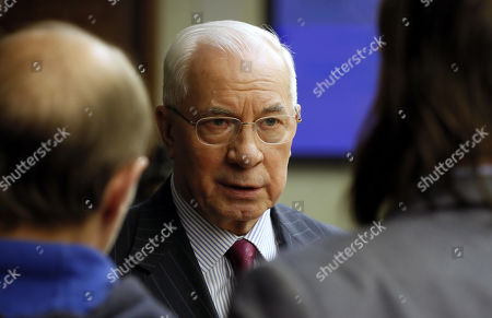 Former Ukrainian Prime Minister Nikolai Azarov looks on prior to a meeting of a working group of the Russian Federation Council's temporary commission on protection of state sovereignty and prevention of interfering into Russian internal affairs at the Federation Council building in Moscow, Russia, 12 February 2019. The meeting was to discuss modern methods of intervention in internal affairs of the sovereign states.