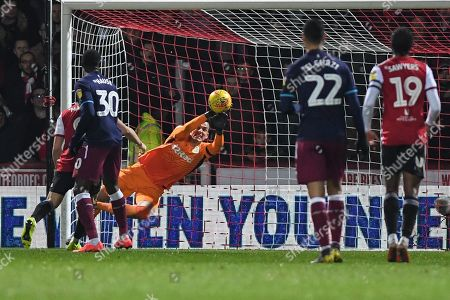 Lovre Kalinic (28) of Aston Villa punches the ball clear