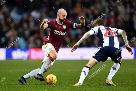 Alan Hutton (21) of Aston Villa battles with Sam Field (28) of West Bromwich Albion