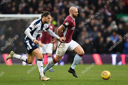 Alan Hutton (21) of Aston Villa battles with Jay Rodriguez (19) of West Bromwich Albion