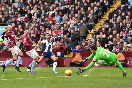 Lovre Kalinic (28) of Aston Villa dives to save a shot from Jacob Murphy (70) of West Bromwich Albion