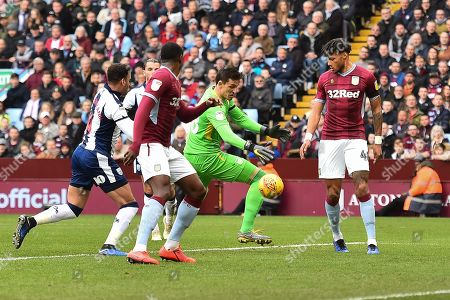 Lovre Kalinic (28) of Aston Villa fumbles and drops the ball