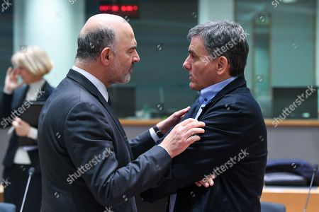 Stock Photo of Pierre Moscovici, Euclid Tsakalotos