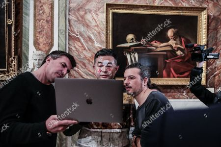 Stock Image of The artist Liu Bolin for the celebration of the Chinese new year portrays himself near the painting ' Saint Gerolamo' by Caravaggio in the Borghese Gallery