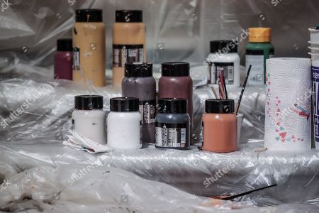 Stock Picture of The colours used by the artist Liu Bolin that for the celebration of the Chinese new year portrays himself near the painting ' Saint Gerolamo' by Caravaggio in the Borghese Gallery