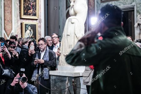 Stock Photo of The artist Liu Bolin for the celebration of the Chinese new year portrays himself near the painting ' Saint Gerolamo' by Caravaggio in the Borghese Gallery