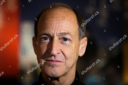 """Director Charles Ferguson poses for a photo prior to an interview with the Associated Press about his movie 'Watergate"""" at the 2019 Berlinale Film Festival in Berlin, Germany"""