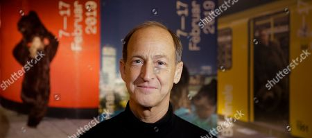 "Stock Photo of Director Charles Ferguson poses for a photo prior to an interview with the Associated Press about his movie 'Watergate"" at the 2019 Berlinale Film Festival in Berlin, Germany"