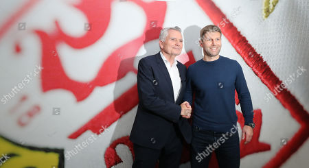 Newly appointed sports director of VfB Stuttgart, Thomas Hitzlsperger (R) and the club's president Wolfgang Dietrich shake hands at a press conference in Stuttgart, Germany, 12 February 2019. The Bundesliga soccer team VfB Stuttgart has dismissed its sports director Michael Reschke.