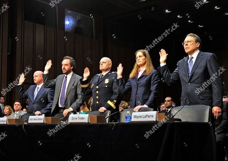From left to right: Captain Mark Kelly, United States Navy (Retired), Americans for Responsible Solutions; Professor David Kopel, Adjunct Professor of Advanced Constitutional Law, Denver University, Strum College of Law; James A. Johnson, Chief of Police, Baltimore County Police Department, and Chair, National Law Enforcement Partnership to Prevent Gun Violence; Gayle Trotter, Attorney and Senior Fellow, Independent Women's Forum; and Wayne LaPierre, Executive Vice President and Chief Executive Officer, National Rifle Association are sworn-in to testify before the U.S. Senate Committee on the Judiciary hearing entitled 'What Should America Do About Gun Violence?' on Capitol Hill in Washington, D.C.