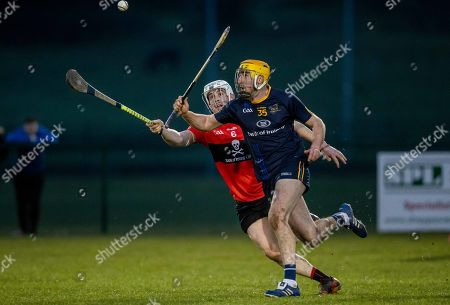 UCC vs DCU. UCC's Eoghan Murphy with Billy Ryan of DCU