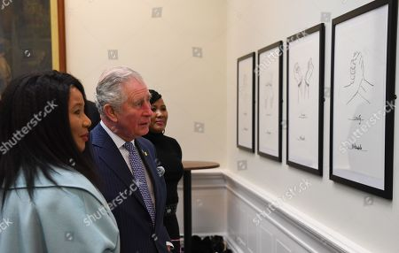 Prince Charles (2L) and Makaziwe Mandela (L), look at drawings by Nelson Mandela on display in St George's Hall in Liverpool