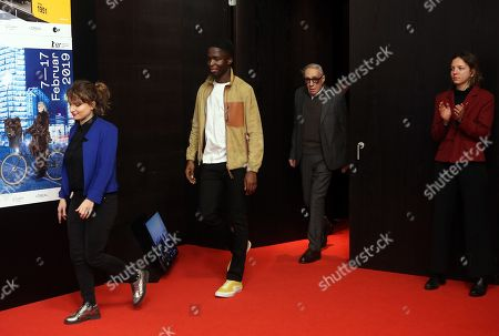 Andre Techine (R) and French actor Stephane Bak (C) attend the press conference of 'Farewell to the night' (L'Adieu a la nuit) during the 69th annual Berlin Film Festival, in Berlin, Germany, 12 February 2019. The movie is presented in the Official Competition at the Berlinale that runs from 07 to 17 February.