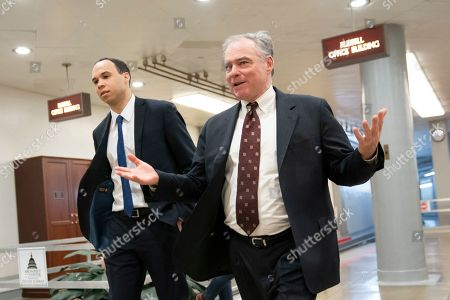 """Sen. Tim Kaine, D-Va., walks to the Senate for the weekly policy luncheon, at the Capitol in Washington, as the Trump administration pushed back against allegations that it was trying to cover up the killing of Saudi columnist Jamal Khashoggi when it failed to send Congress a report determining who was responsible for his death. """"This amounts to the Trump administration aiding in the cover-up of a murder,"""" said Kaine"""