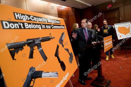 Bob Menendez, Richard Blumenthal. Sen. Richard Blumenthal, D-Conn., center, accompanied by Sen. Bob Menendez, D-N.J., third from right, speaks at a news conference on an proposed amendment to ban high capacity magazines in guns, on Capitol Hill, in Washington