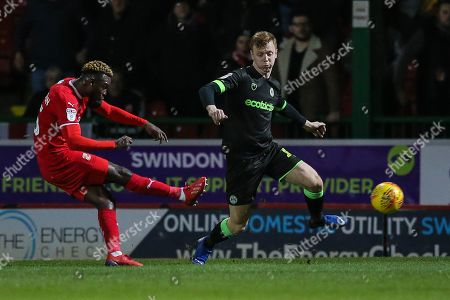 Swindon Town's Theo Robinson(35) shoots at goal scores a goal 2-0 during the EFL Sky Bet League 2 match between Swindon Town and Forest Green Rovers at the County Ground, Swindon