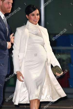 Meghan Duchess of Sussex arrives at the Natural History Museum gala performance of 'The Wider Earth' in support of The Queen's Commonwealth Trust and The Queen's Commonwealth Canopy.